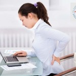 Businesswoman With Laptop Having Back Ache